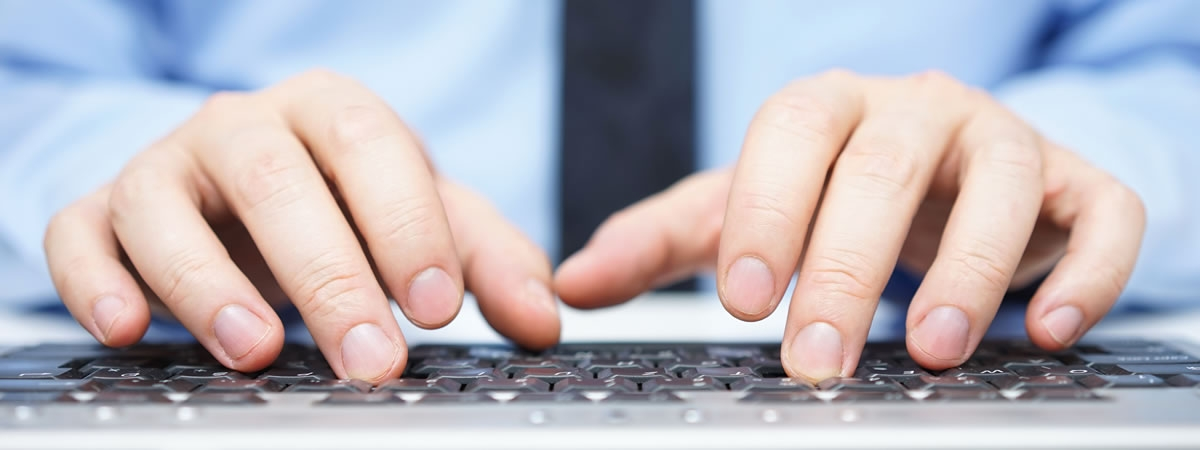picture of man at keyboard